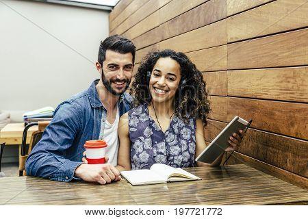 Interracial college couple preparing their next exam
