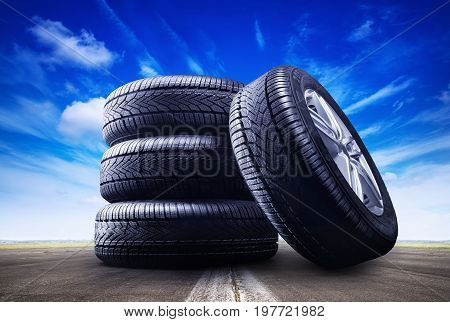 four car wheels under a blue sky