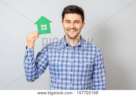Man Holding Model Of House. Buying A House Concept