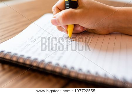 Girl Writing By Hand On Notepad
