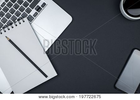 Modern Designer Office Desk Table With Blank Notebook Page, Laptop Computer And Cup Of Coffee