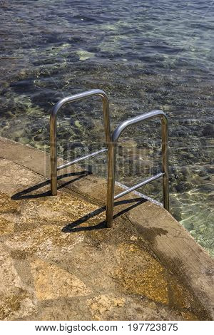 Close Of Metal Stairs To Sea Water 2