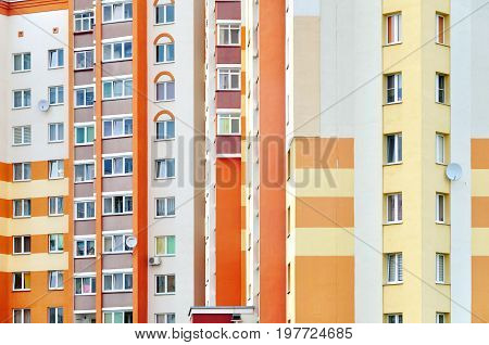 Grodno, Belarus - July 18, 2017: Highrise modern residential building. Front view of white red and yellow facade.