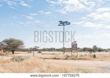 OKAHANDJA NAMIBIA - JUNE 19 2017: Sign boards for the Okonjima Africat reserve between Okahandja and Otjiwarongo in the Otjozondjupa Region of Namibia