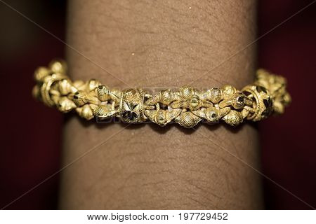 wrist 24 carats gold bracelet  skin   luxury  jewelry