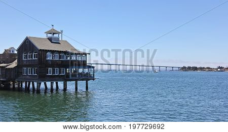 SAN DIEGO, CALIFORNIA, JUNE 9. Seaport Village on June 9, 2017, in San Diego, California. The Pier Cafe restaurant in Seaport Village, popular with locals and tourists alike.