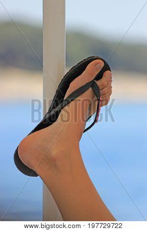 Woman Leg With Beach Flip Flops