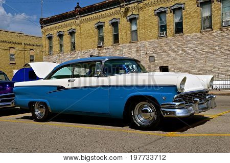 CASSELTON, NORTH DAKOTA, July 27, 2017: The annual Casselton Car Show which occurs the last Thursday of July features classic vehicles such as the 1955 two door Ford.