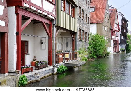 Ancient half-timbered buildings in the fishermen's quarter in Ulm, Baden-Wurttemberg, Germany. Houses standing on the water channel.