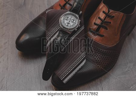 Businessman accessories. Man's style. Shoes with watch