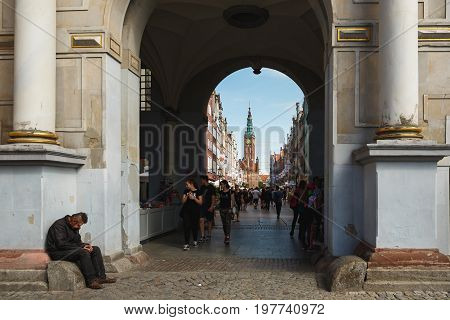 Gdansk Poland - July 22 2017: The beggar nearby the arch in the old town of Gdansk in summer