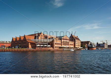 Gdansk Poland - July 22 2017: The Philharmonic Society of Gdansk reflected in the water in early morning