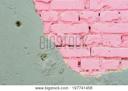 Abstract beautiful wall of grey cement and pink bricks. Rough damaged shabby texture with cracked. With place for your text, for background use