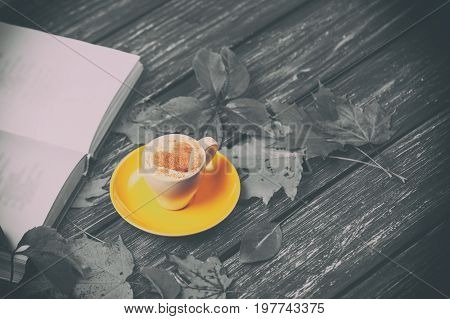 Autumn Leaves, Book And Coffee Cup On Wooden Table.
