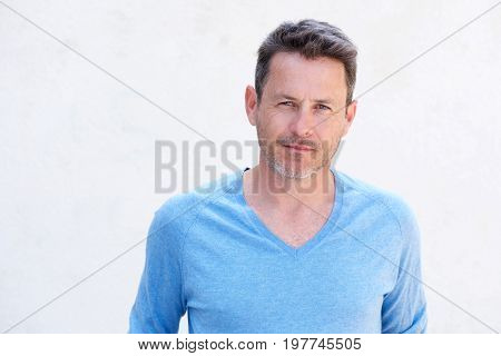 Close Up Handsome Older Man Standing And Thinking