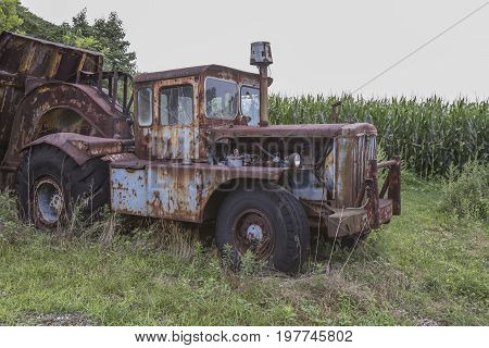 Cab Of Rusting Farm Truck In Field