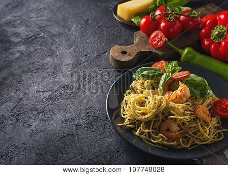 whole grain spaghetti pasta with shrimp top view copy space