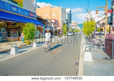 Nara, Japan - July 26, 2017: Unidentified people biking and walking at the streets and visit a shopping area in Nara, Japan. Nara is a former capital city of Japan. Nowadays it's a big city inhabited by 368, 636 people.