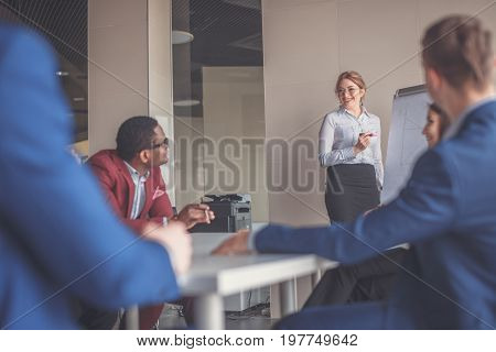 businesswoman giving presentation using flipchart in office