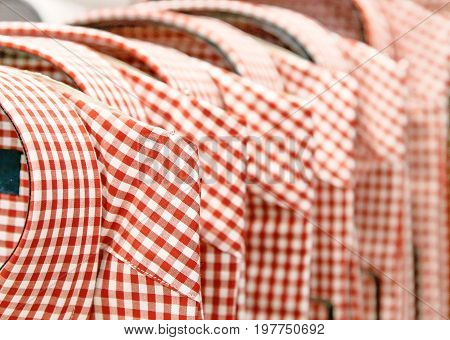 Stack of plaid shirts in a department store.