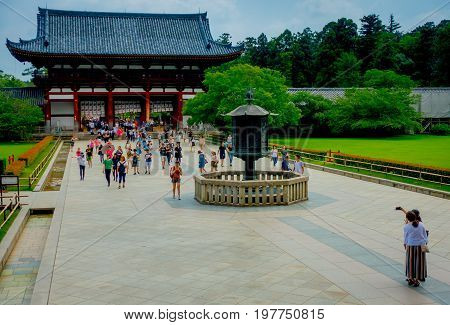Nara, Japan - July 26, 2017: Unidentified people walking at Todai-ji literally means Eastern Great Temple. This temple is a Buddhist temple located in the city of Nara, Japan.