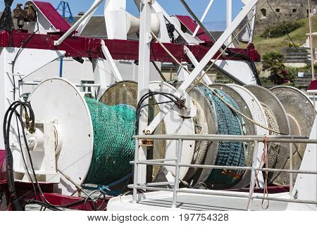 Fishing colored net on boat industrial fish