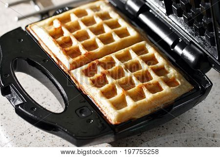 hash browns made in waffle maker kitchen hack. Just cooked, delicious, tasty, hot potatoes waffles with on waffle iron. Dinner is ready. Sweet golden brown waffles