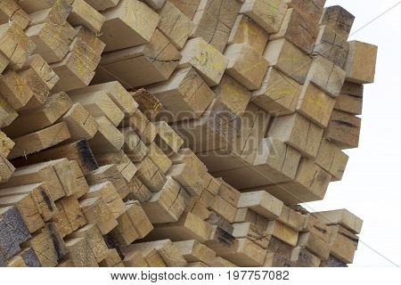 Sawn wooden boards and bars in a pack in stock Russia