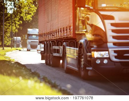 asphalt roadwith a tilt truck. lorry moving on sunny evening
