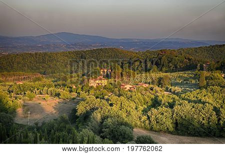 Rural countryside landscape in Tuscany region of Italy. Sunset light.