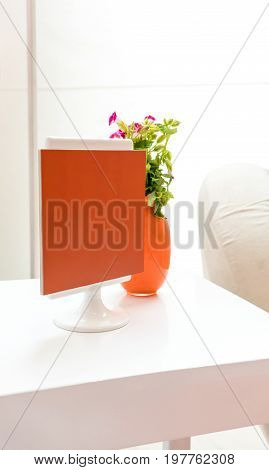 Decorative side table setup with mini photo frame against white background. Close up detail in living service area. Interior design in modern style.