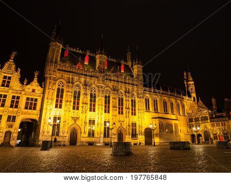 Burg square with the City Hall by night, Bruges, Belgium.