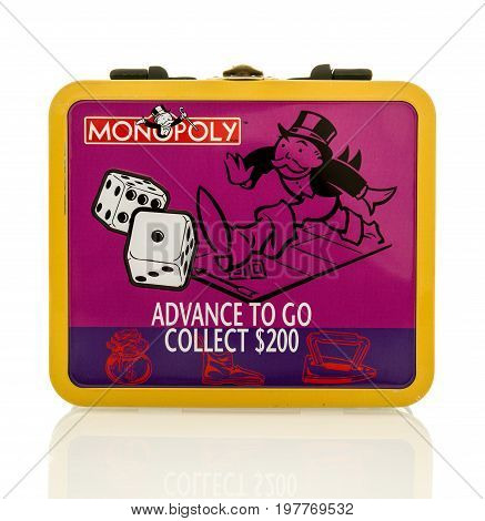 Winneconne WI -30 July 2017: A Monopoly lunch box featuring advance to go and collect $200 on an isolated background.