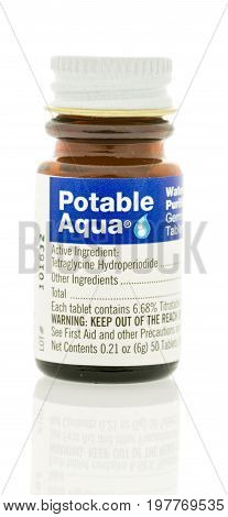 Winneconne WI -30 July 2017: A bottle of Potable Aqua tablets to help clean water before drinking on an isolated background.