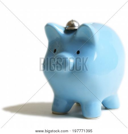 An isolated image of a baby blue piggy coin bank for use as a design element.