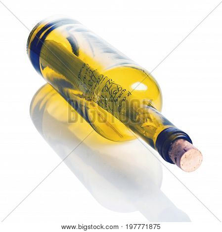 Wine bottle with a cast-away note inside asking for help. The bottle and also the reflection have separate clipping paths for easy removal.