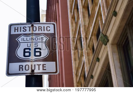 Historic Illinois Route 66 brown sign in Chicago.