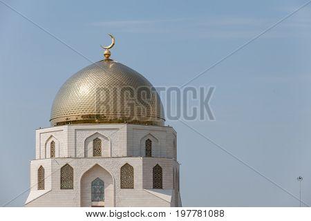 Beautiful mosque golden shine minarets against the blue sky