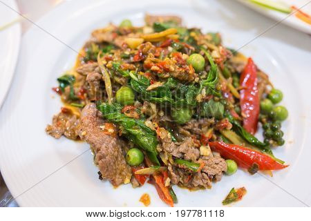 Closup Stir-fried beef on white plate ,Thai food.