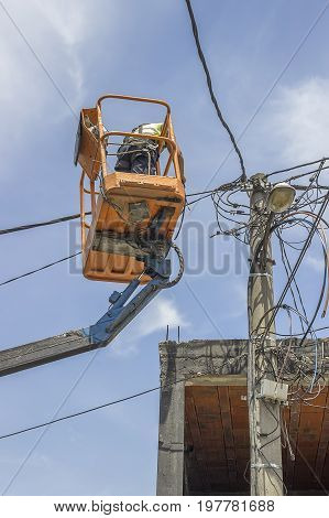 Utility Pole Worker Replacing Cables On An Electric Pole 2