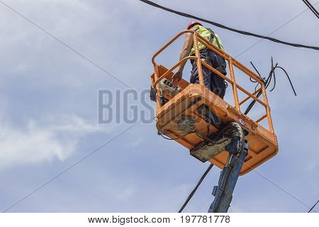 Utility Worker Fixes The Power Line