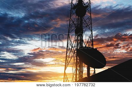 Silhouette Telecommunication tower with Satellite dish, under sunset sky