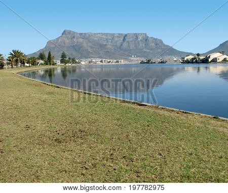 FROM CAPE TOWN, SOUTH AFRICA, MILNERTON LAGOON, WITH THE SHADOW OF TABLE MOUNTAIN ON THE WATER 36vh