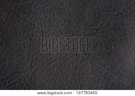 Old gray leather background close-up. Grunge grey skin texture