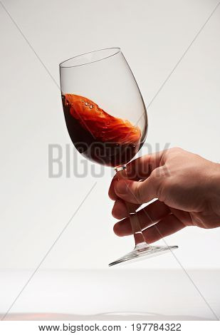 Smooth red wine drink in glass isolated on white background