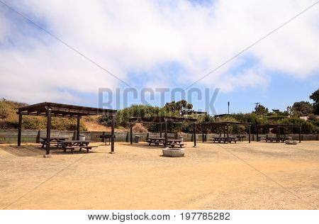 Picnic table and BBQ grill at San Clemente State Beach campgrounds in Summer in Southern California