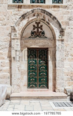 Jerusalem Israel July 14 2017 : The entrance door to the Armenian part of the Church of the Holy Sepulchre in Jerusalem Israel.