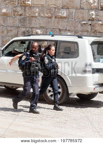 Jerusalem Israel July 14 2017 : Two policemen patrol the streets in the old city of Jerusalem Israel.