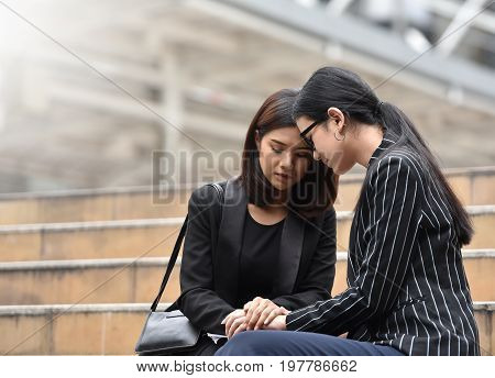 Sadness Young Asian Business women crying and sitting on the stair. Sacked.