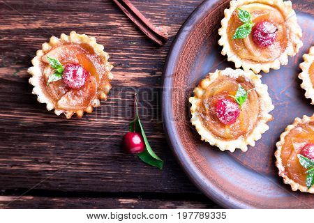 Apple Caramel Little Tarts On Brown Rustic Background. French Tatin With Paradise Apple. Top View.